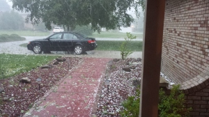 My car, getting damaged. That's hail in July.